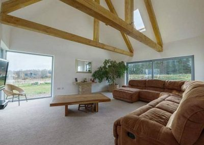 Luxury eco new build in tarlogie Tain, with a 3 bay larch clad garage, wood burner & solar heating